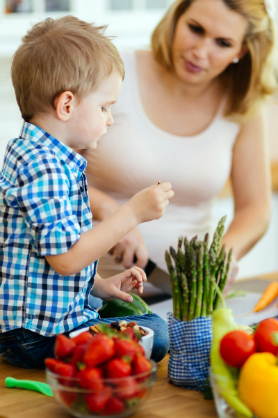 Thrive by Spectrum Pediatrics image for hour with an expert service is a child and mother preparing food together for mealtime