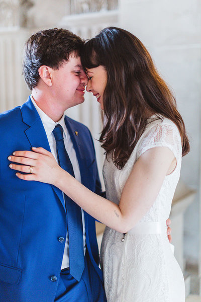 couple caressing at City Hall with bride and groom by San Francisco City Hall wedding photographer Zoe Larkin Photography