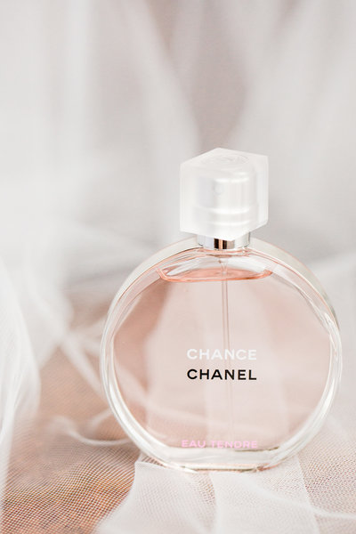 Detail picture of a Chanel perfume on a veil