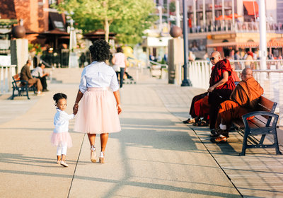 Little girl with mom walking hand in hand dressed with matching dusty pink tulle skirts