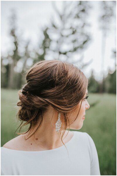Bride with beautiful earrings and hair in Knoxville Tennessee