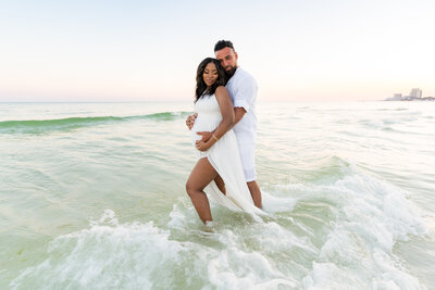 Whitney Sims Photography specializes in wedding, engagement, and family photography. She services Navarre Beach, Destin, and surrounding areas along Florida's gulf coast