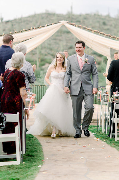 Saguaro Buttes Wedding Photo of Bride and Groom Walking Down the Aisle by Tucson Wedding Photographer Bryan and Anh | West End Photography