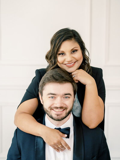 North Carolina wedding photographers, Radhika and Ian, smile for a photo