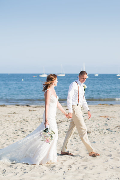 Bride and groom walk on the beach in Santa Barbara