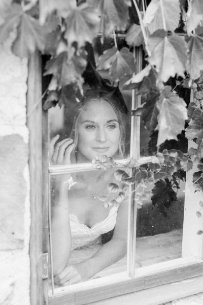 Bride peeking through window photo