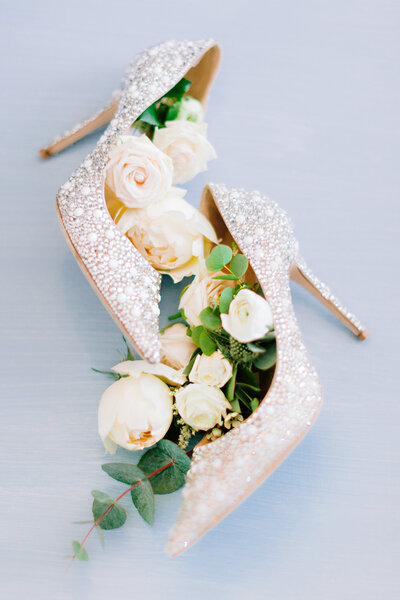 Dreamy Wedding shoes filled with luxury flowers and foliage