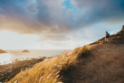 Hawaii elopement photographer watches the sunrise from the Lanikai Pillbox trail on Oahu, Hawaii