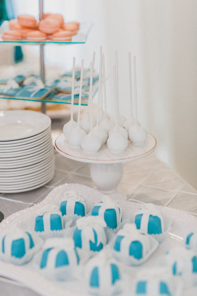white cake pops with blue desserts and cookies