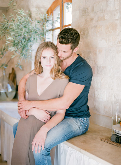 Lifestyle engagement session, shot in film in Italian style villa, couple in kitchen with morning sun at Sunstone Estate Winery, California central coast, Santa Ynez Valley , Santa Barbara, fine art photographers Evonne and Darren