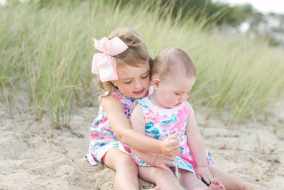 Sisters share a moment on the beach in Nantucket