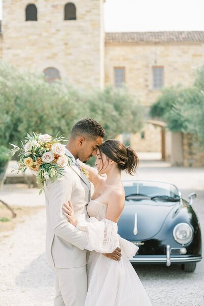 Bride & Groom in front of Classic Black Car