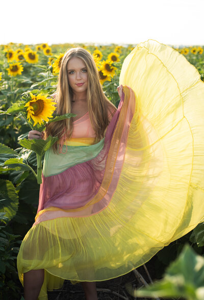 girl in flowy yellow dress sunflower fieldl