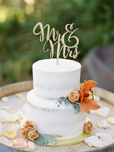 wedding cake with a mrs and mr sign on top