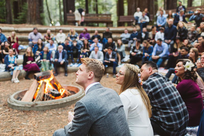 bride and groom around campfire in camp mendocino wedding