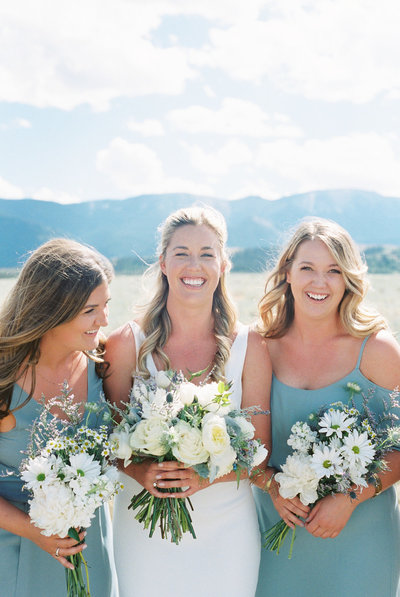 Bridesmaids in Blue at Luxury Montana Ranch Wedding