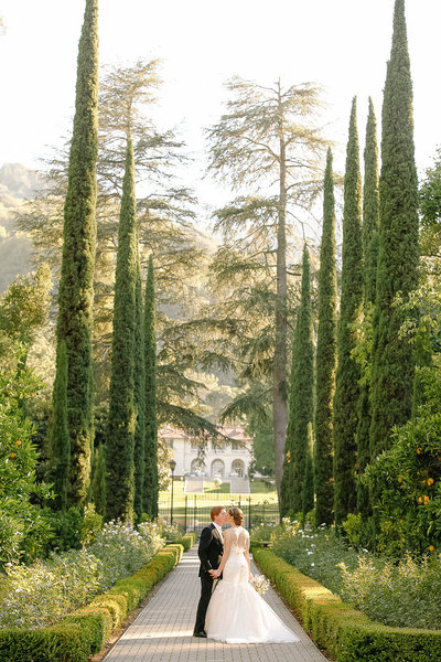 Bride and groom on hill at Villa Montalvo