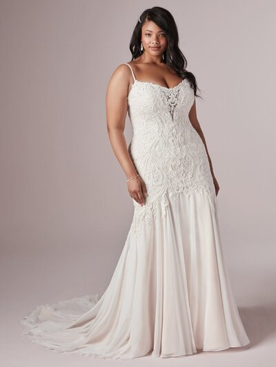 Beaded and appliqued with elegant finishes, this strapless gown is utterly timeless.