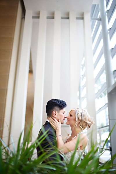 Bride and Groom kissing at their wedding at Hard Rock Hotel  San Diego