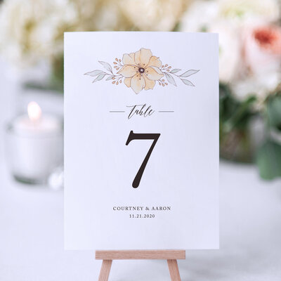 table number design with orange florals