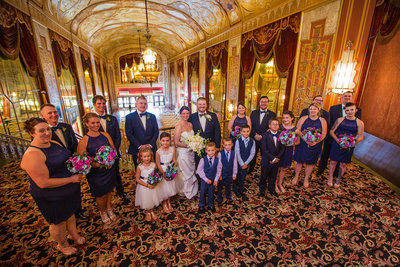 Bridal party gathered at the top of the Grand Staircase at the Warner Theatre