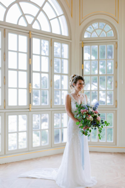 bride in front of a window in chateau saint george in Grasse South of France