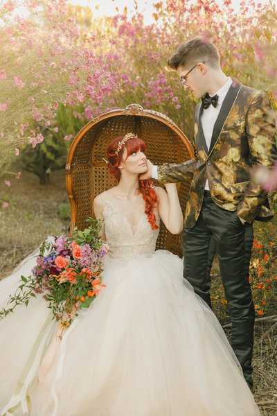 Fairytale portrait session of couple in a flower garden on a farm styled shoot