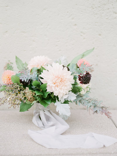 Wedding bouquet with cafe au lait dahlias, privet berries, and purple acacia.