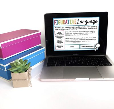 A figurative language presentation appears on a computer beside two boxes and a plant.