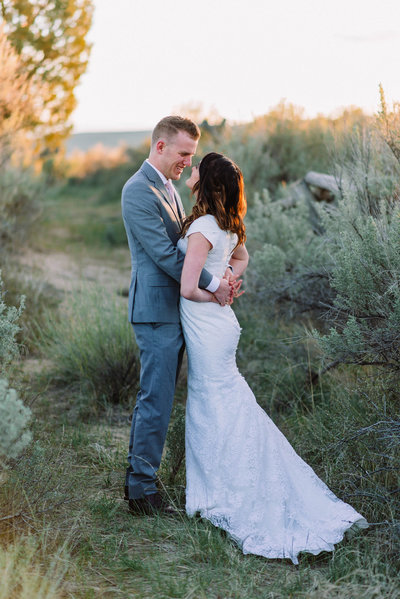 idaho bride and groom looking at each other