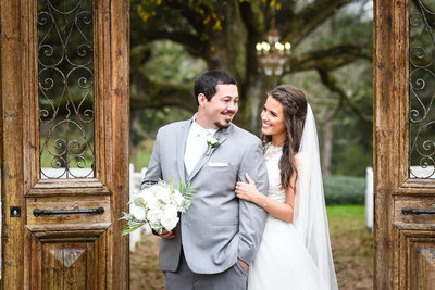 Couple under arch at  The Venue at Southern Oaks Farm, Gulfport, MS, Mississippi Wedding