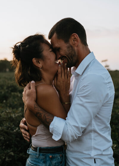 couple holding each other at sunset