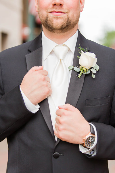 Groom detail photo of black suit photographed at the Onesto in downtown Canton by a akron ohio wedding photographer