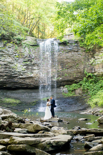 This adventurous couple chose to renew their vows at the base of this gorgeous waterfall at Cloudlanyd Canyon in Georgia. Photo by Rebecca Cerasani.