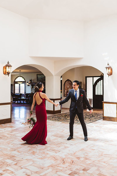 asian couple dancing at wedding red dress