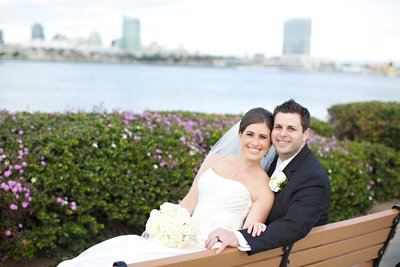 Bride and Groom sitting on bench at Centennial Park Wedding Venue
