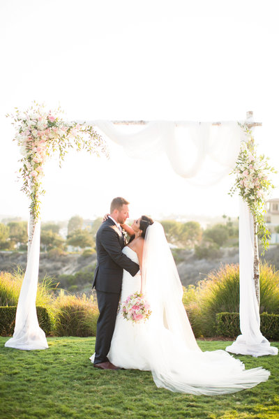 Bride and Groom portrait at their ceremony site at The Crossings in Carlsbad
