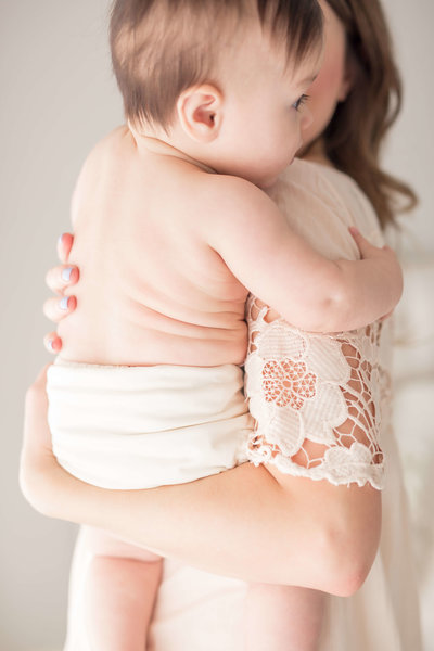 chubby baby being held by mommy