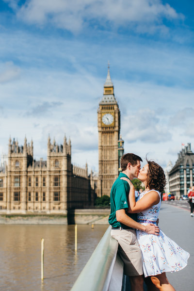 Young couple kissing in front of Big Ben in London for romantic portrait