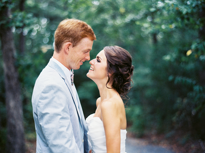 Happy rustic bride and groom smile before a kiss together for their rustic farm wedding in Atlanta ga | photo taken by J.J. Au'Clair