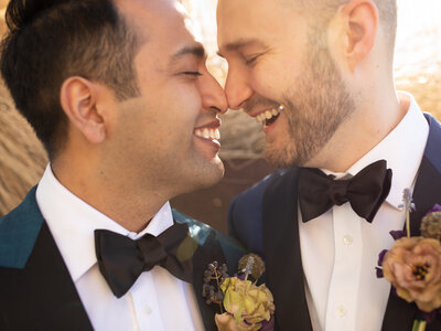 groom and groom smiling