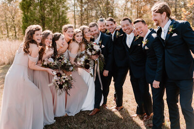 fun candid bridal party at fall nashville wedding at ashland city farms