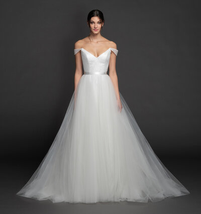 Tara Keely by Lazaro bridal gown - Ivory glitter tulle ball gown, V-neckline front and back with off the shoulder cap sleeve, sparkle net bodice, ribbon at natural waist, circular skirt with chapel train.