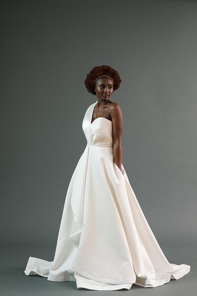 Model wearing the Kimi asymmetrical a-line wedding dress from the Edith Elan 2019 bridal collection