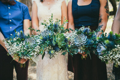 Bridal party holds their succulent filled wedding bouquets