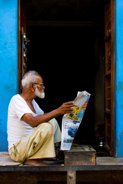Old Man Reading News