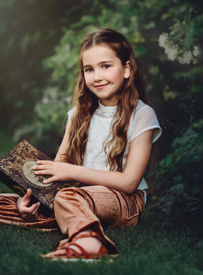 Young girl poses for photo outside in nature