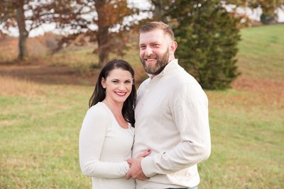 couples portrait smiling in Lynchburg Virginia during the fall