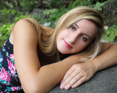 Senior Portraits of girl laying on arms  in Port Wentworth, GA