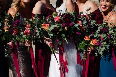 Bride and bridesmaids holding their wedding flower bouquets